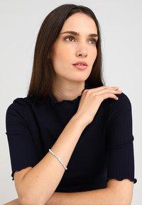 Swarovski - TENNIS BRACELET - Bracelet - silver-coloured - 0