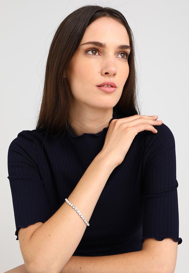 Swarovski - TENNIS BRACELET - Bracelet - silver-coloured