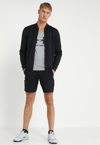 Under Armour - VANISH SHORTS - Sports shorts - black - 1