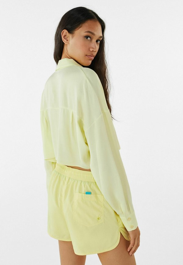 Bershka MIT TASCHE - Koszula - light yellow/jasnożÓłty SGWX