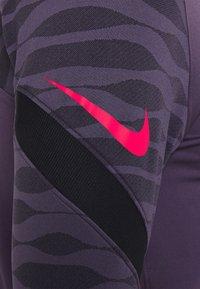 Nike Performance - Sports shirt - dark raisin/black/siren red - 7