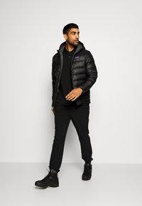 Patagonia - HOODY - Down jacket - black - 1