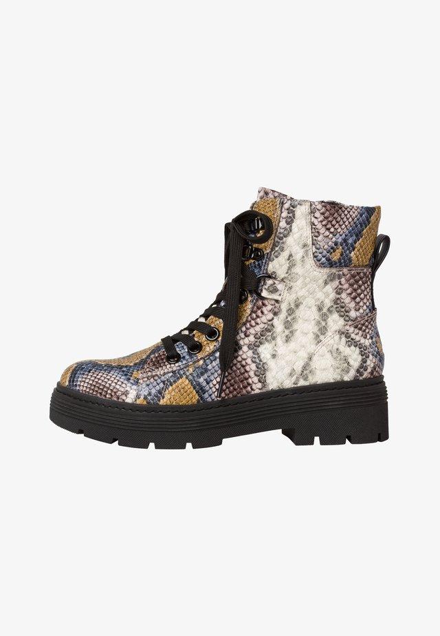 STIEFELETTE - Platform ankle boots - saffron m.s.c