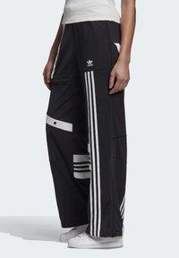 adidas Originals - DANIËLLE CATHARI JOGGERS - Pantalon de survêtement - black - 2