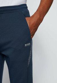 BOSS - HADIKO  - Tracksuit bottoms - dark blue - 3