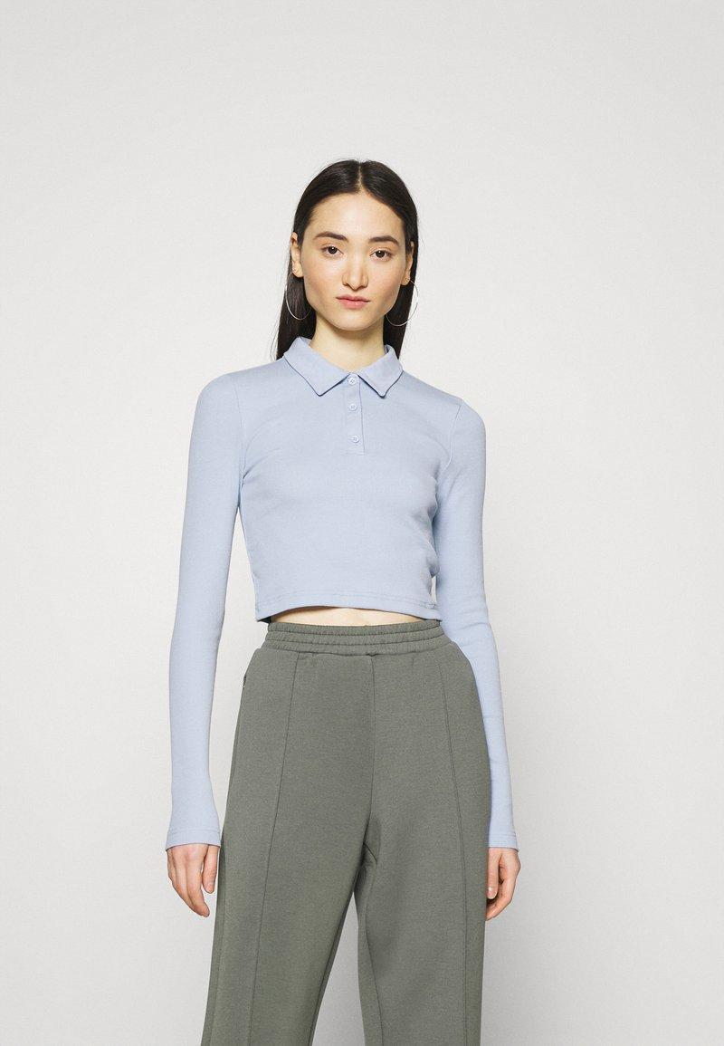 Weekday - ERIN - Polo shirt - light blue