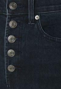 GAP - HARVARD - Flared Jeans - dark wash - 2