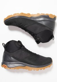 Salomon - OUTSNAP CSWP - Winter boots - black/ebony - 1