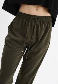InWear - GERDA - Tracksuit bottoms - olive - 2