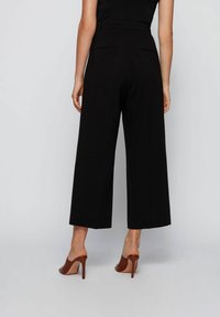 BOSS - TAYAMANA - Trousers - black - 2