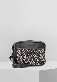 Cowboysbag - Across body bag - black/beige - 0
