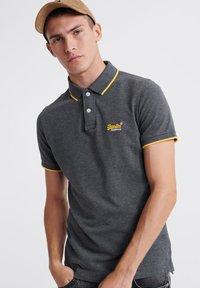 Polo shirt - black/grey marl