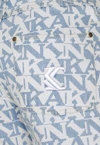 Karl Kani - Straight leg jeans - light blue - 7