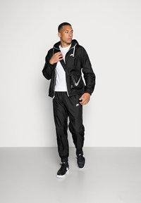 Nike Sportswear - Tepláková souprava - black - 1