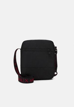CROSSBODY UNISEX - Across body bag - black/red