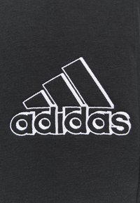 adidas Performance - ESSENTIALS RELAXED - Tracksuit bottoms - black - 6