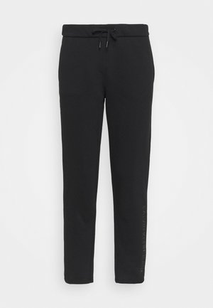 SHINY RAISED PANT - Tracksuit bottoms - black