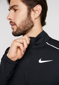 Nike Performance - Sportshirt - black/reflective silver