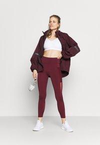 Sweaty Betty - MISSION JACKET - Waterproof jacket - plum red - 1