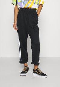 adidas Originals - BF ADICOLOR PRIMEBLUE RELAXED PANTS - Tracksuit bottoms - black - 0