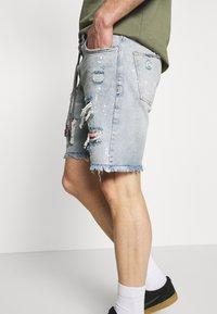 The Couture Club - BANDANA PATCH AND PAINT SPLAT CUT OFFS - Denim shorts - vintage blue - 3