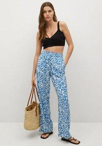 Mango - MERY - Trousers - light blue - 1