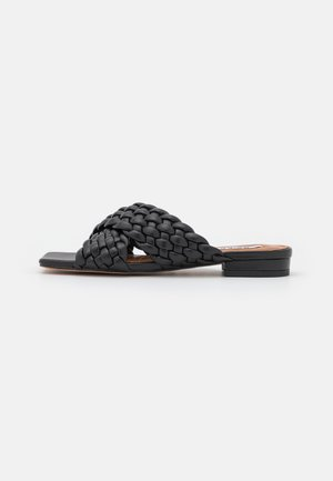 CROSSED BRAIDED FLATS - Mules - black