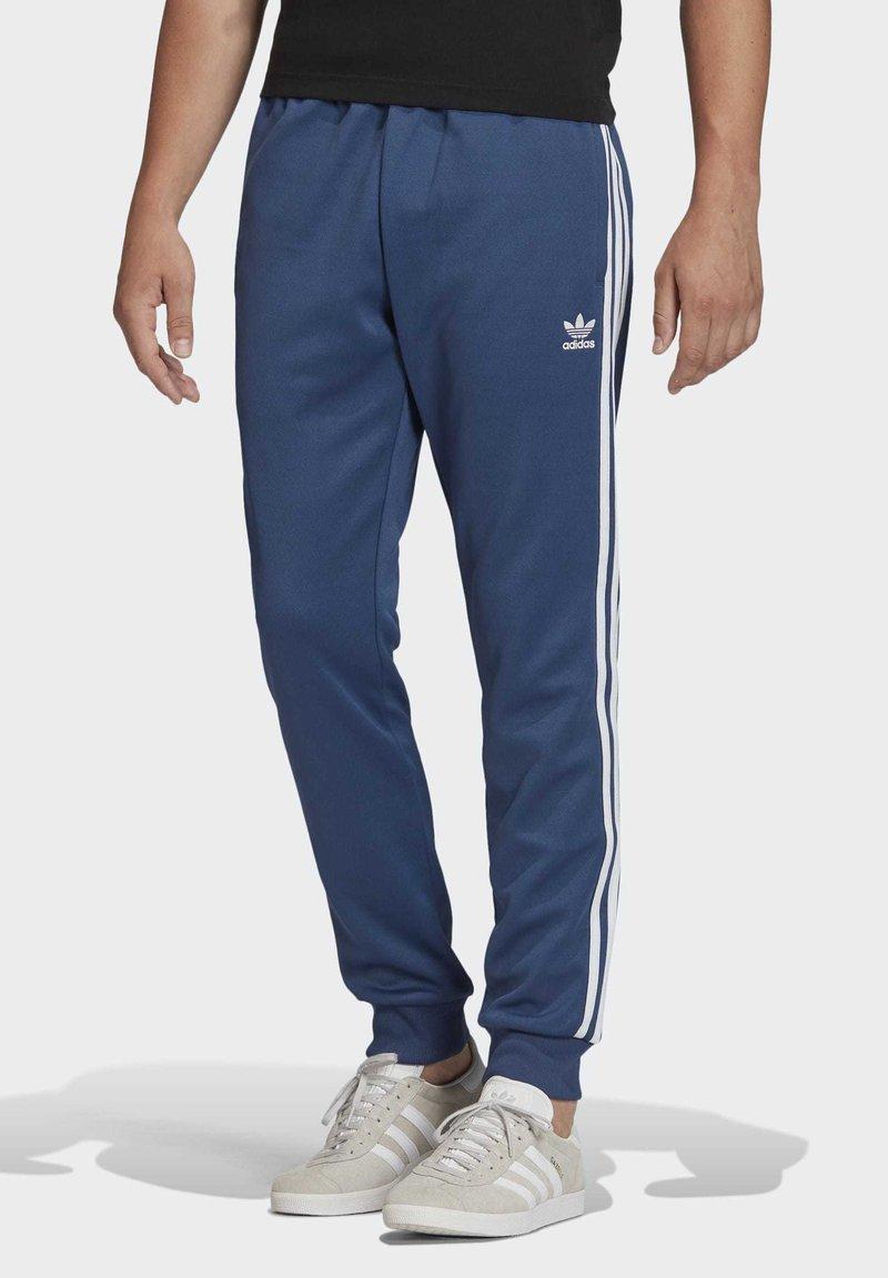 adidas Originals - TRACKSUIT BOTTOM - Trainingsbroek - blue