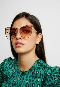 Alexander McQueen - Sunglasses - gold/orange - 1