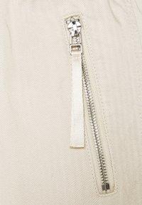 s.Oliver - Teplákové kalhoty - light sand - 2