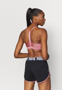 Puma - LOW IMPACT STRAPPY BRA - Sport-bh met light support - foxglove - 2