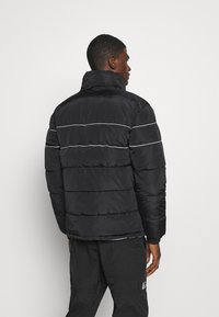 Karl Kani - RETRO REVERSIBLE PUFFER JACKET - Winter jacket - black - 3