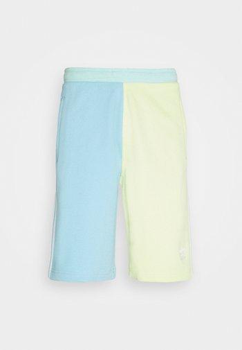 BLOCKED UNISEX - Shorts - yellow tint/hazy sky