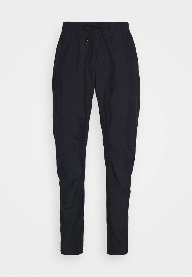 TECH LIGHT PANT - Ulkohousut - black