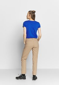Jack Wolfskin - DESERT ROLL UP PANTS - Outdoor trousers - sand dune - 2