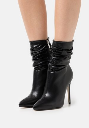 BELLO - Classic ankle boots - black