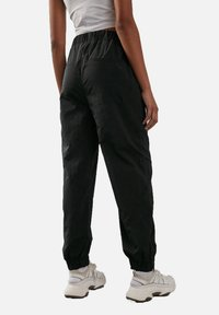 NA-KD - Tracksuit bottoms - black - 1