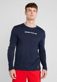 Nike Performance - DRY RUN SEASONAL  - Camiseta de deporte - obsidian/white - 0