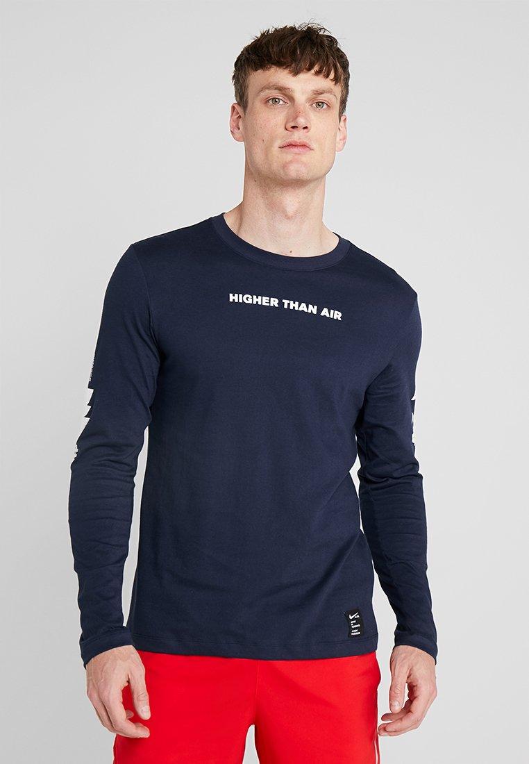 Nike Performance - DRY RUN SEASONAL  - Camiseta de deporte - obsidian/white