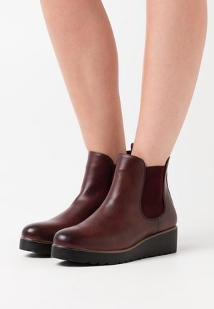 Ankle boots - dark red