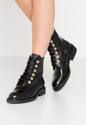 Lace-up ankle boots - black/gold