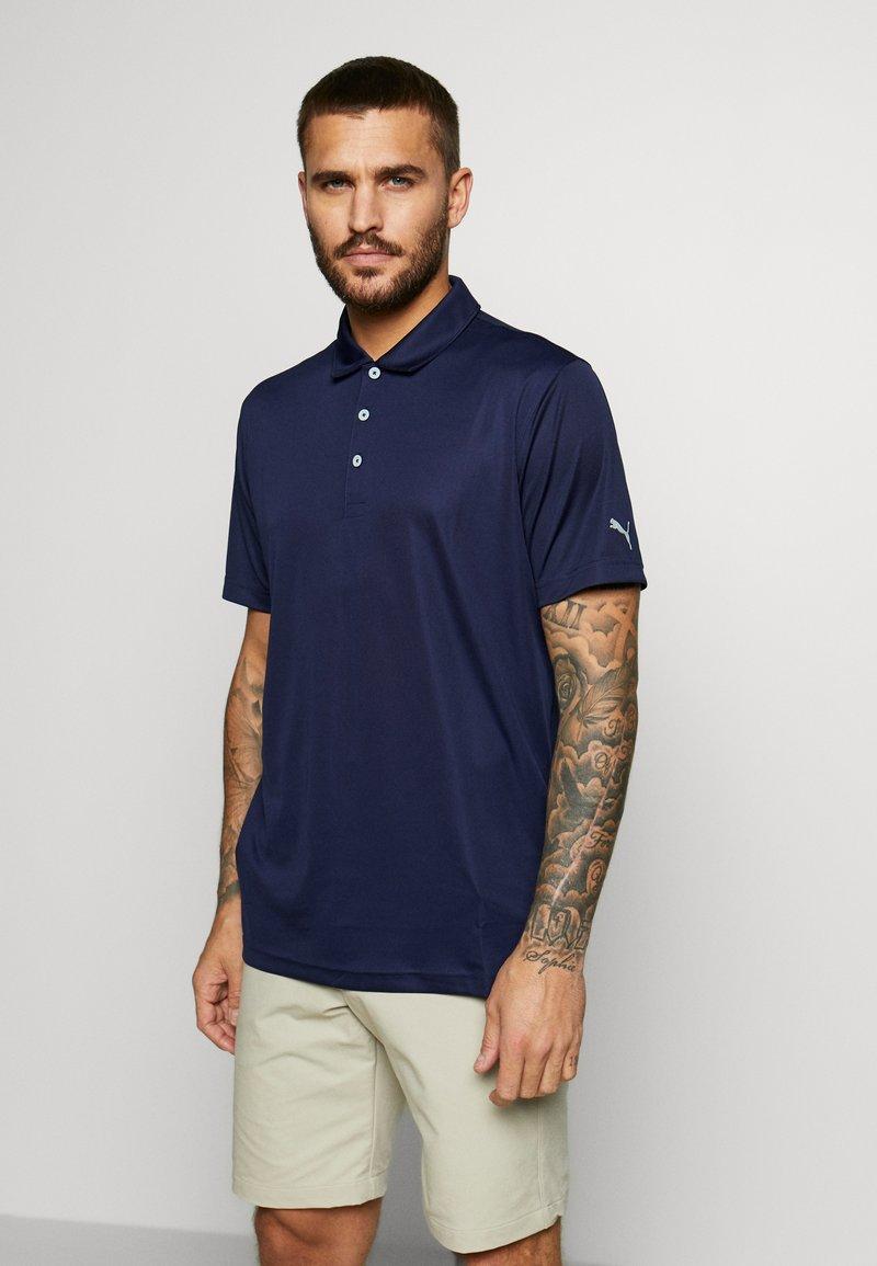 Puma Golf - ROTATION - Sports shirt - peacock