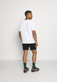 Calvin Klein Jeans - LOGO - Tracksuit bottoms - black - 2