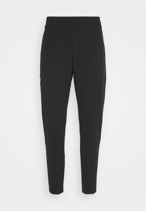 DOUBLE PANTS - Tracksuit bottoms - black