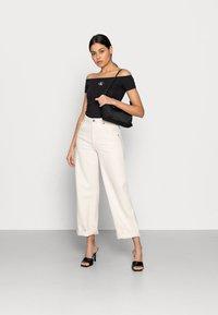 Calvin Klein Jeans - MONOGRAM SLIM BARDOT TOP - Print T-shirt - black - 1