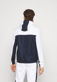 Lacoste Sport - TRACK JACKET - Verryttelytakki - white/navy blue - 2