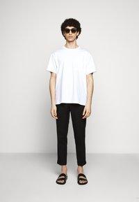 Filippa K - TERRY CROPPED SLACKS - Trousers - black - 1