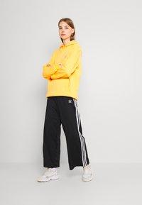 adidas Originals - TRACK PANTS - Pantalones deportivos - black - 1
