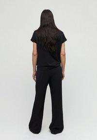 ARMEDANGELS - HANNAA - Trousers - black - 2