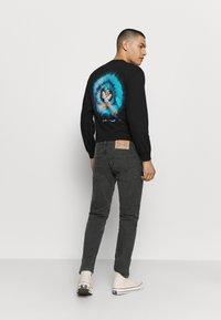 Levi's® - 502™ TAPER HI BALL - Jeans Tapered Fit - black denim - 2